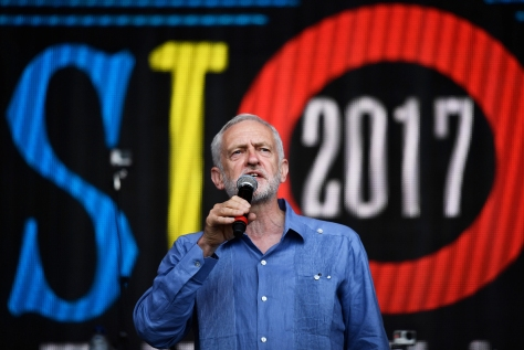 Britain's opposition Labour Party leader Jeremy Corbyn addresses revellers from the Pyramid Stage at Worthy Farm in Somerset during the Glastonbury Festival in Britain