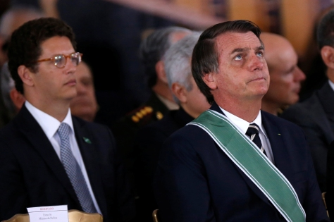 Brazil's President Jair Bolsonaro, Environment Minister Ricardo Salles and Vice President Hamilton Mourao attend a swearing-in ceremony for the country's new army commander in Brasilia