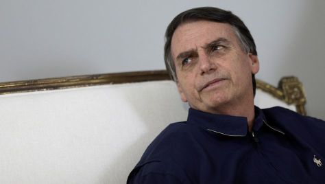 Presidential candidate Jair Bolsonaro attends a news conference at a campaign office in Rio de Janeiro