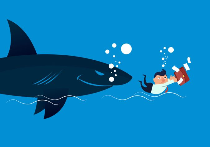 Businessman chased by shark
